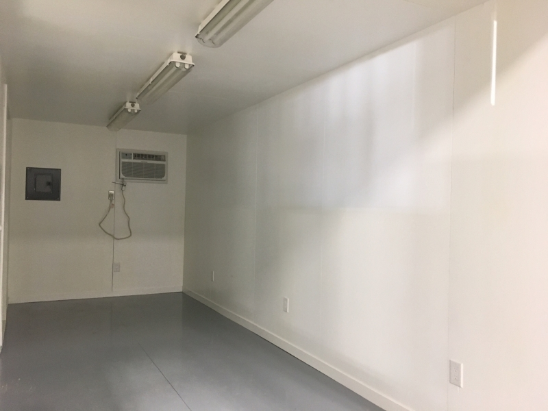 white interior of a c-can converted into an office at ace high storage